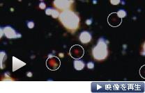 丸で囲んだ赤い天体が約127億光年先にある銀河