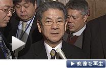警戒監視を強化したと話す北沢防衛相(26日、国会内)